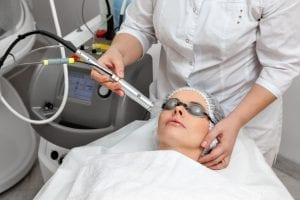Patient receiving treatment at cosmetic dermatology office