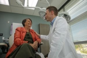 Doctor seeing patient at the skin care treatment center in orlando.